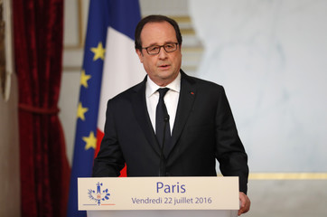 French President Francois Hollande delivers a statement after a defence council at the Elysee Palace in Paris