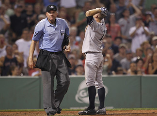 New York Yankees Brett Gardner reacts after he was ejected from the game by home plate umpire Mike Everitt during the fifth inning of American League MLB baseball action at Fenway Park in Boston