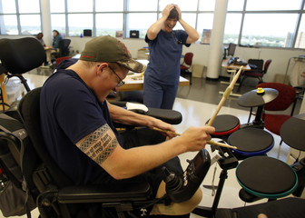 File photo of Sgt. Matt Krumwiede playing drumming computer game during occupational therapy in San Antonio, Texas