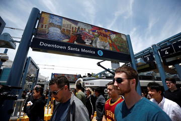 Passengers disembark at the Downtown Santa Monica station on L.A. Metro's new $1.5 billion Expo Line extension that connects downtown to the beach for the first time in 63 years, in Santa Monica