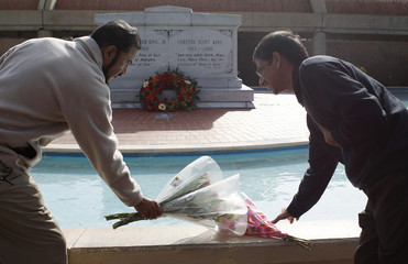 Bharmal and Nair of the Ghandi Foundation place flowers at the crypt of Martin Luther King, Jr. and his wife Coretta Scott King on the the 45th Martin Luther King, Jr. Annual Commemorative ServiceMartin Luther King Day in Atlanta