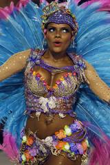 A reveller from the Vila Isabel samba school participates in the annual Carnival parade in Rio de Janeiro's Sambadrome