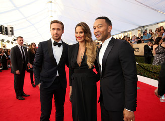 Actor Gosling greets Legend and Tiegen as they arrive at the 23rd Screen Actors Guild Awards in Los Angeles