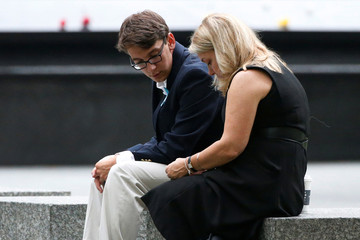 Guests sit near the memorial before the start of the ceremony marking the 15th anniversary of the attacks on the World Trade Center, at The National September 11 Memorial and Museum in New York
