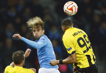 Napoli's Henrique fights for the ball with BSC Young Boys' (YB) Guillaume Hoarau during their Europa League group I soccer match at the Stade de Suisse stadium in Bern