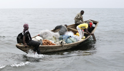 Fishermen set out for their expedition from the shores of Lake Kivu in Goma, eastern DRC