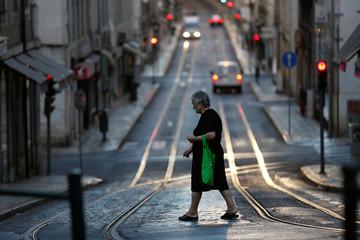 A woman walks in downtown Lisbon