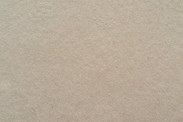 texture of a cardboard or paper material of beige color