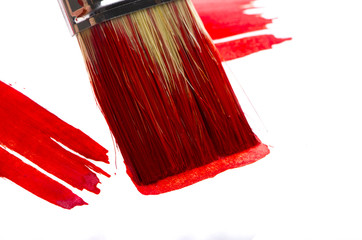 Red brush in red paint