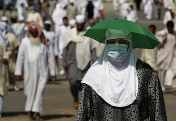 Muslim pilgrims make their way to perform prayers at the Grand Mosque upon their arrival in Mecca