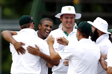 Philander of South Africa is joined by Smith to celebrate the dismissal of Clarke who was bowed out by Vernon during the fifth day of the second test  in Johannesburg
