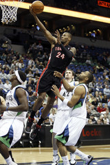 Raptors' Weems shoots a layup over Timberwolves' Ellington during their NBA basketball game in Minneapolis