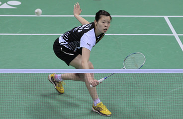 Li of China returns a shot against Schenk of Germany during India Open Super Series badminton tournament in New Delhi