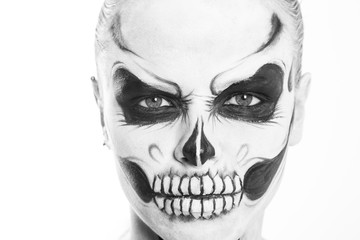 Girl with creative halloween face art on white background.