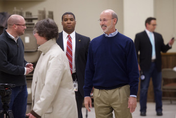 Democratic challenger for Pennsylvania Governor Tom Wolf and wife, Frances, arrive to vote on U.S. midterm election day in Mount Wolf