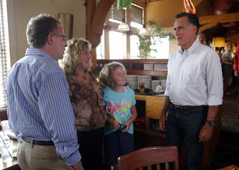 Republican presidential candidate and former Massachusetts Governor Mitt Romney talks to diners while stopping to pick up two pizzas at Lui-Lui restaurant in West Lebanon