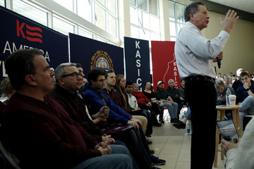 U.S. Republican presidential candidate John Kasich speaks to voters during a campaign town hall in Nashua