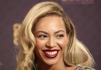 "Singer Beyonce poses for photographs at ""The Sound of Change"" concert at Twickenham Stadium in London"