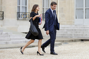 French Culture Minister Filippetti and French Minister for Industrial Recovery Montebourg leave the weekly cabinet meeting at the Elysee Palace in Paris