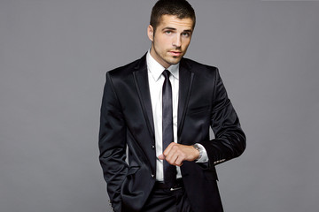 Male model in black suit, studio