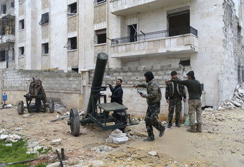 Rebel fighters prepare mortar at al-Breij frontline, after what they said was advance by them in al-Manasher and al-Majbal areas where forces loyal to President al-Assad were stationed, in Aleppo