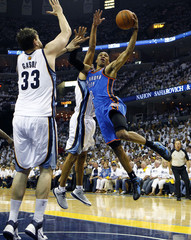Oklahoma City Thunder Russell Westbrook drives to the basket by Memphis Grizzlies Marc Gasol and Shane Battier in Memphis