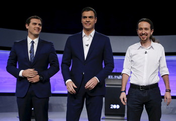 Three of the main candidates for Spain's national election pose before taking part in a live debate in Madrid