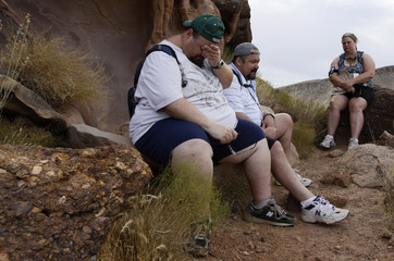 Guests at the Biggest Loser Resort in Ivins, Utah rest during one of their daily hikes