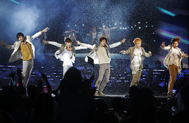 SHINee of South Korea's S.M. Town performs in the rain at The Float at Marina Bay in Singapore