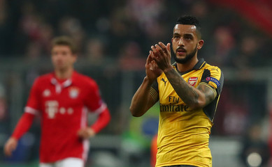 Arsenal's Theo Walcott applauds fans after the game