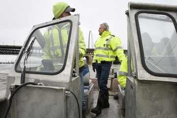 U.S. Geological Survey (USGS) hydro technicians, Eric Looper, Paul Rydlund and Jason Carron measure flood waters on the Mississippi River, in St. Louis, Missouri