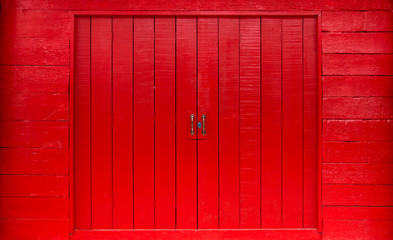 Ancient wooden door painted red