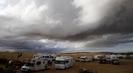 Storm clouds pass over the Imperial Sand Dunes Recreation Area in Glamis