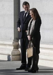 Spanish Prime Minister Mariano Rajoy and his wife Elvira Fernandez attend a memorial mass in the Almudena cathedral on the tenth anniversary of the Madrid train bombings