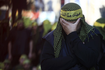 A Lebanese Hezbollah supporter mourns during a ceremony to mark Ashura in Beirut's suburbs