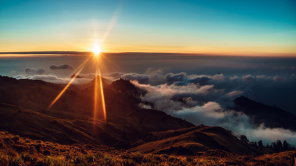 sunset in the mountains above the clouds, Rinjani, Lombok, Indonesia