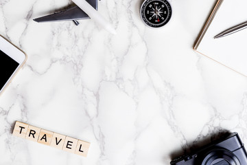 Travel accessories with marble copy space in the middle