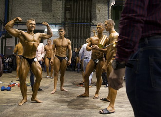 Participants prepare backstage during Belarus bodybuilding and fitness championship in Minsk