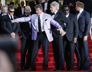 """Actor Sylvester Stallone and cast members of the film """"The Expendables 3"""" pose on the red carpet during the 67th Cannes Film Festival in Cannes"""