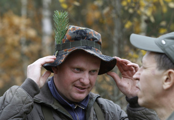 A Belarussian hunter smiles after a successful hunt for wild boars in a forest near the village of Barovka