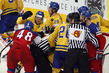 Players of Sweden and the Czech Republic scuffle during the second period of their men's ice hockey World Championship bronze medal game at Minsk Arena in Minsk