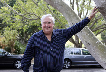 Controversial billionaire Clive Palmer poses for pictures at his golf resort and spa in Coolum, Sunshine Coast