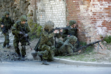 Estonian army soldiers train for urban fighting during the Spring Storm military exercise near the country's eastern border in Rapina