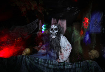 A person is dressed in a scary costume in a local house turned into a haunted one during Halloween celebrations in Leucadia