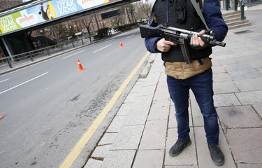 A police officer stands guard during a security control check in central Ankara