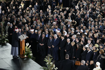 Mourners stand during funeral services for three of the victims of the deadly shooting at the Quebec Islamic Cultural Centre, in Montreal