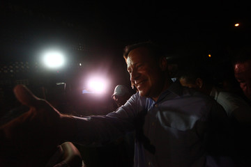 Varela of the Panamenista Party, shakes hands with supporters during his first public presentation as the elected president of Panama outside Virgin of Carmen church in Panama City