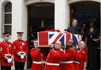 Soldiers carry the coffin of Lance Sergeant Dale McCallum of 1st Battalion Scots Guards after his funeral service in London
