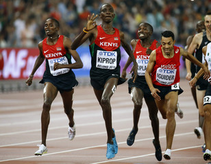 Kenya's Asbel Kiprop (C) celebrates as he crosses the finish line to win the men's 1500 metres final during the 15th IAAF World Championships at the National Stadium in Beijing
