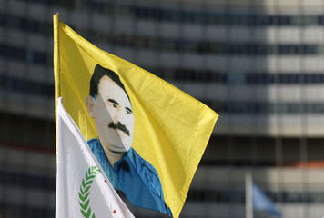 A flag with the picture of Ocalan is displayed in front of UN headquarters in Vienna